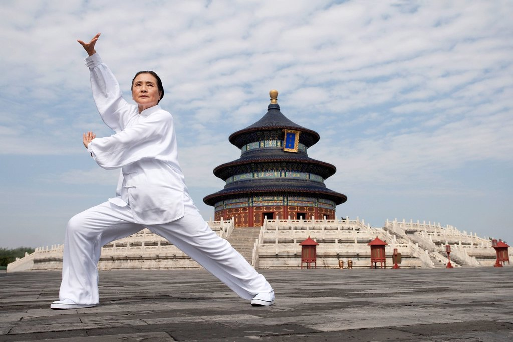 Senior Woman Practicing Tai Chi, Temple of Heaven : Stock Photo