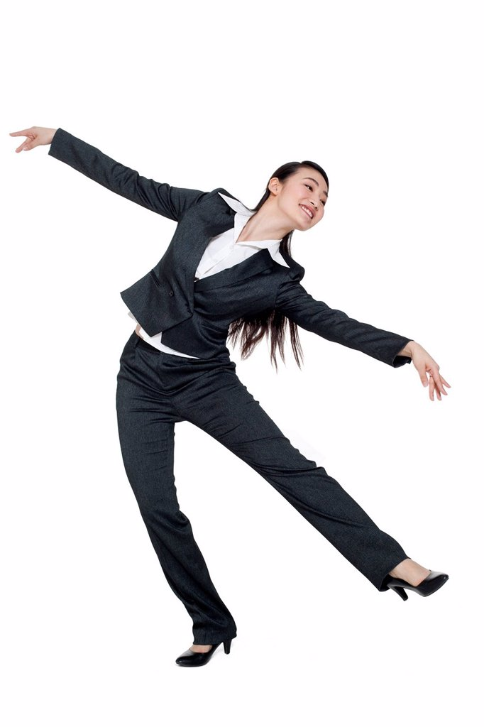 A businesswoman dancing : Stock Photo