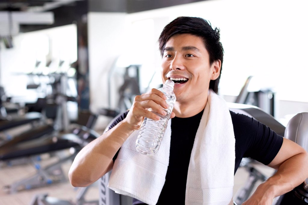 Stock Photo: 1839R-22787 Young Man Drinking Water at Gym