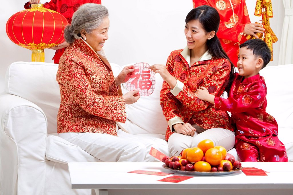 Stock Photo: 1839R-22969 Family Celebrating Chinese New Year