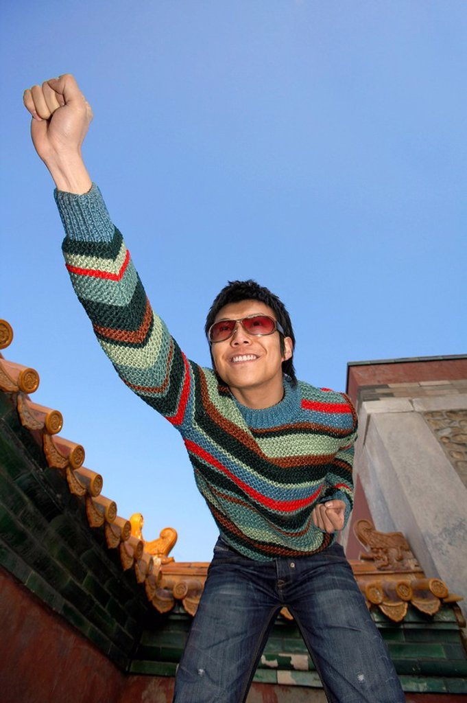 Stock Photo: 1839R-2303 Young Man Posing For Photo At The Forbidden City