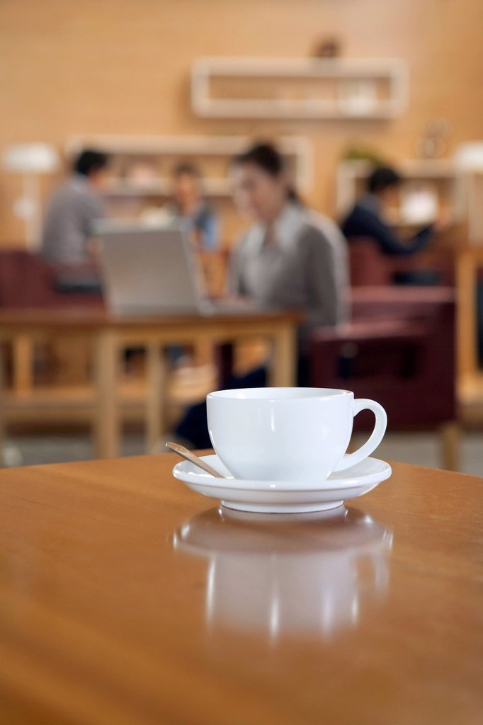 Stock Photo: 1839R-23363 A coffee cup on a table