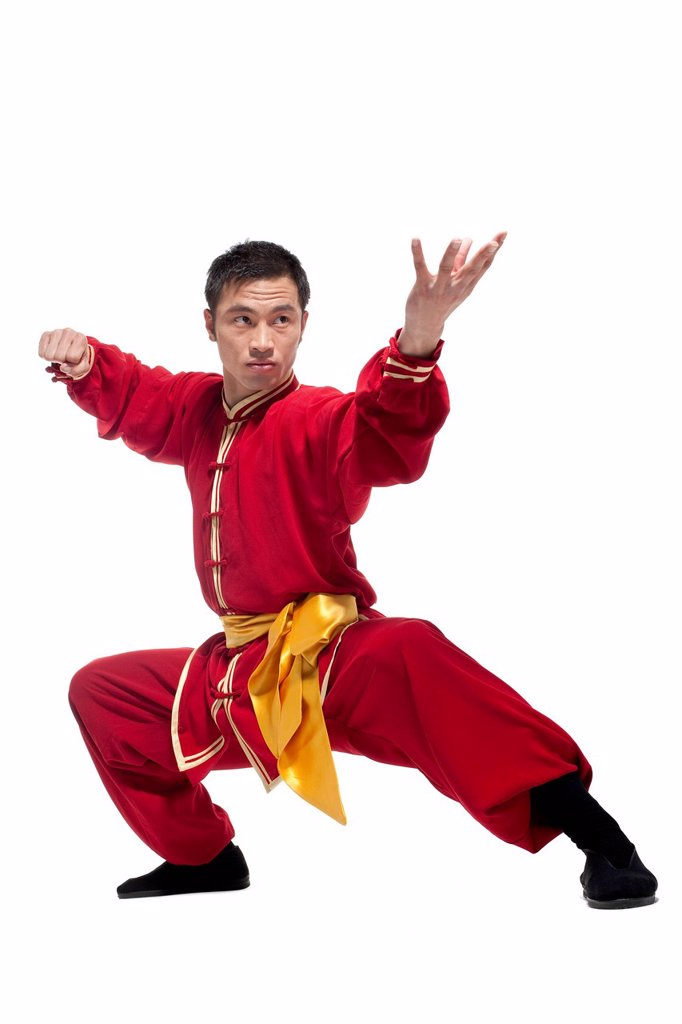 Stock Photo: 1839R-23434 Man In Traditional Chinese Clothing doing Martial Arts
