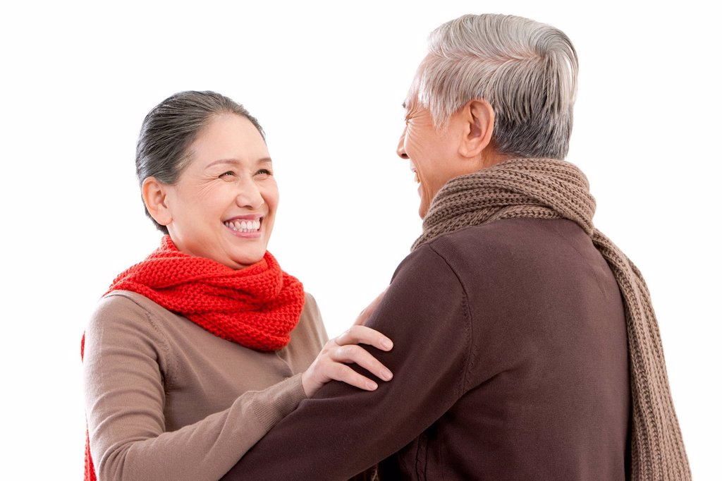 Stock Photo: 1839R-23800 Senior affectionate couple embracing