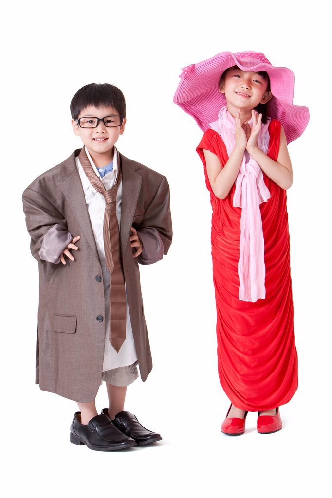 Boy and girl dressing up like adults : Stock Photo