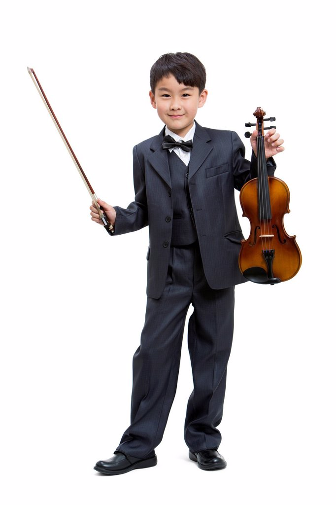 Boy holding a violin : Stock Photo