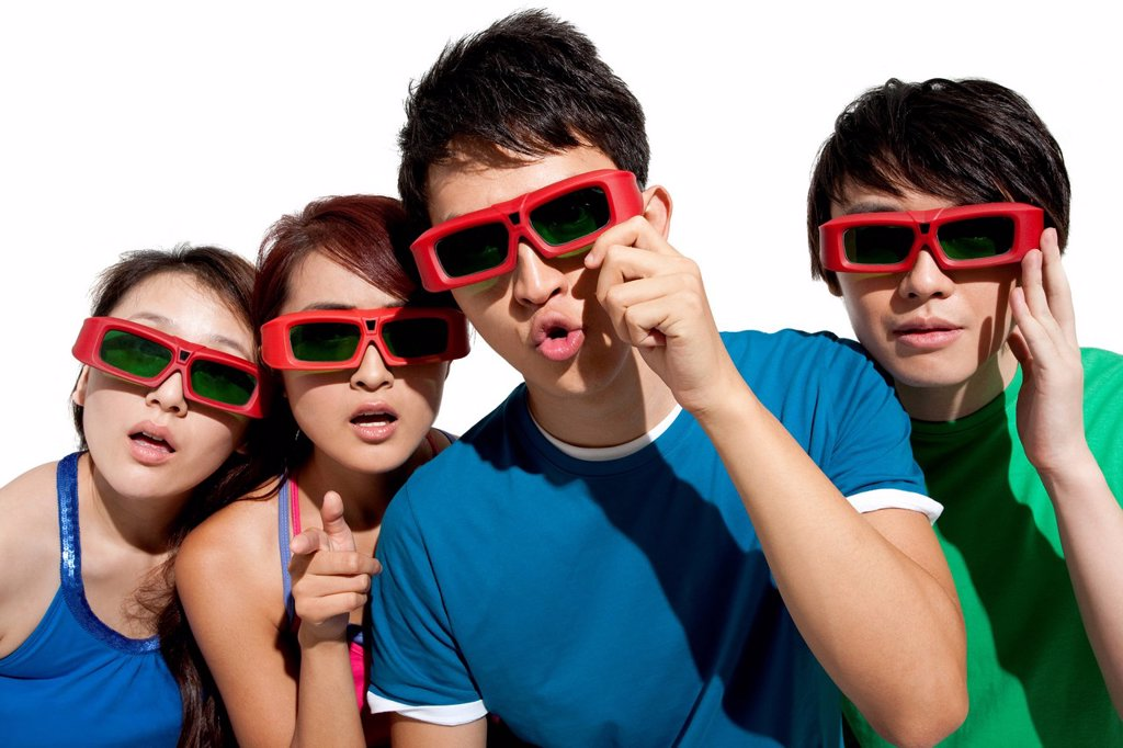 Stock Photo: 1839R-24383 Young people waching 3D movie