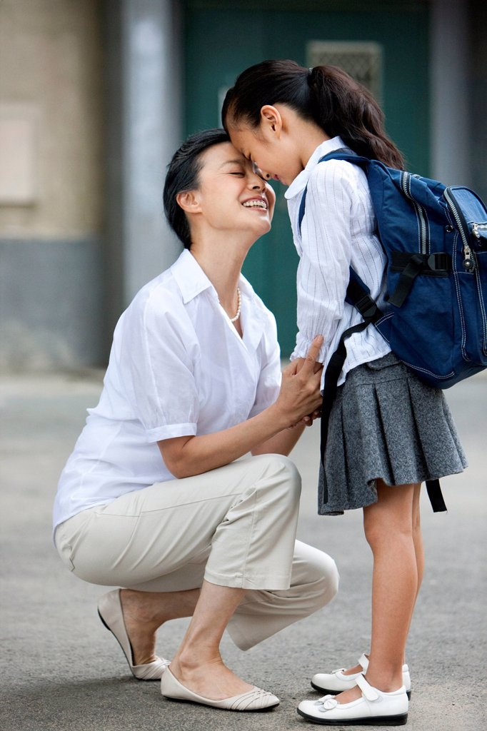 Chinese schoolgirl with grandmother : Stock Photo