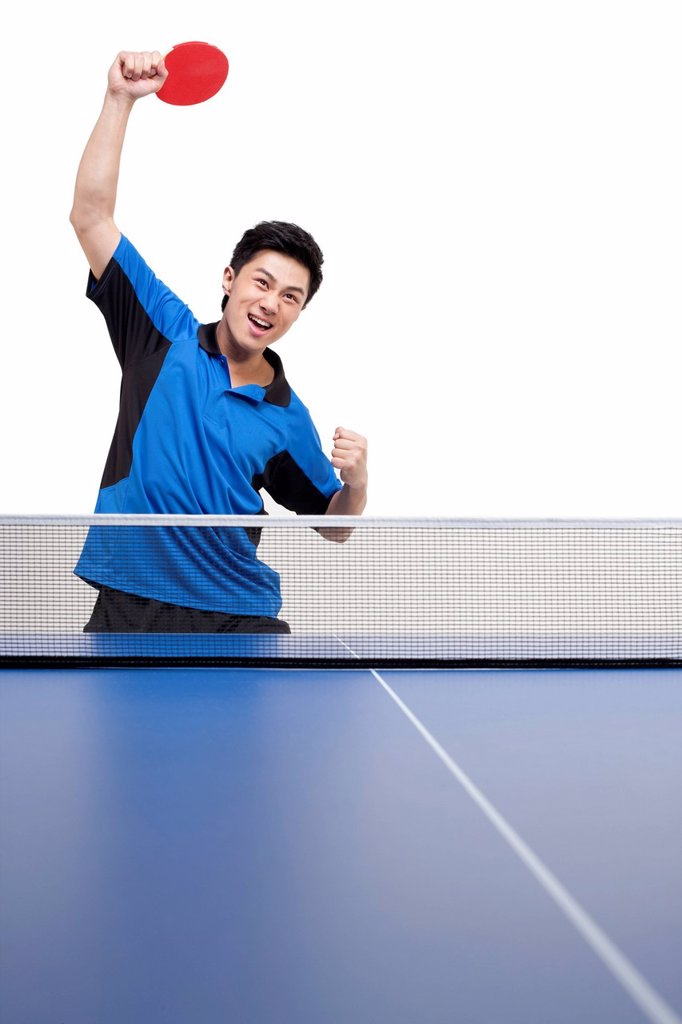 Stock Photo: 1839R-24619 Table tennis player practices swings with determination