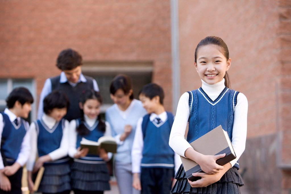Stock Photo: 1839R-24945 Young student standing confidently in the foreground