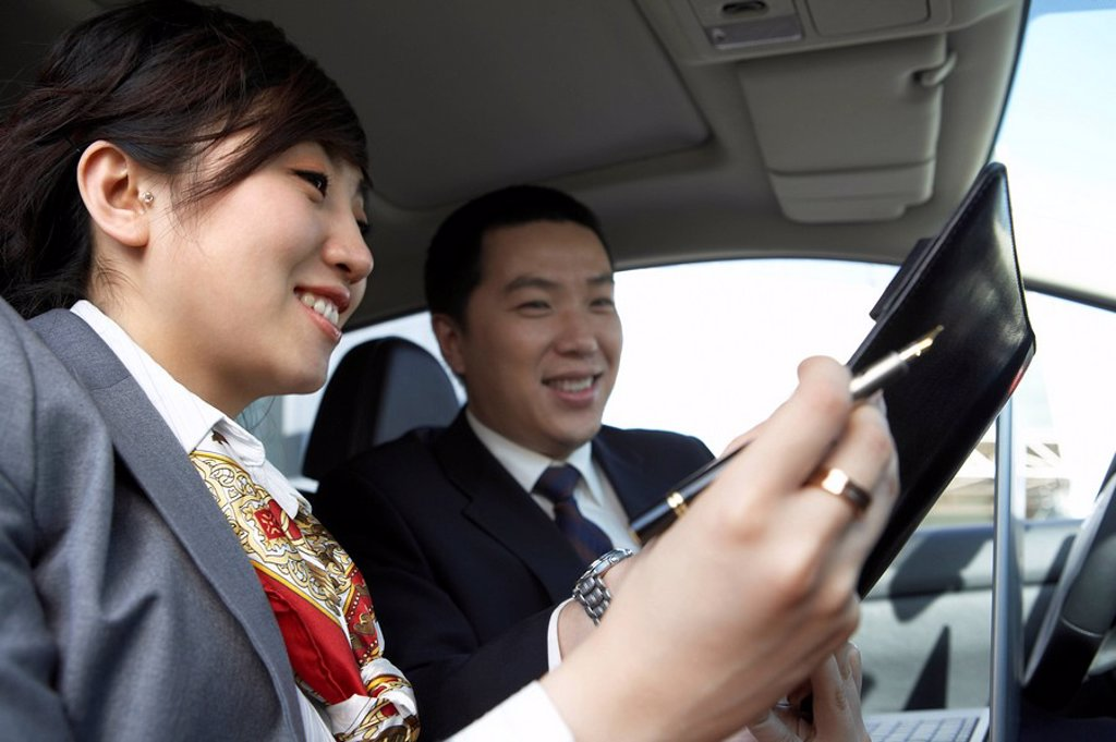 Stock Photo: 1839R-2523 Businesspeople Sitting In Car