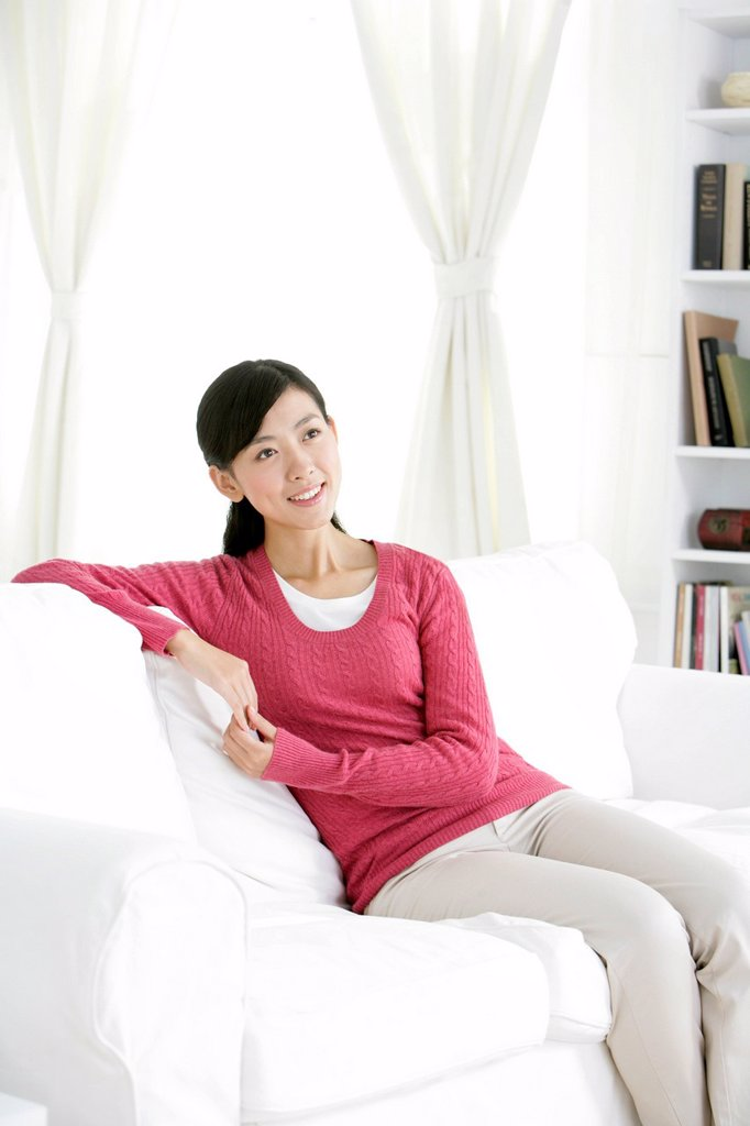 Stock Photo: 1839R-25325 Young Chinese woman in a living room