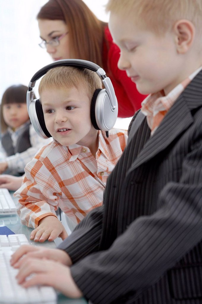 Young Boys Sitting At Computer : Stock Photo