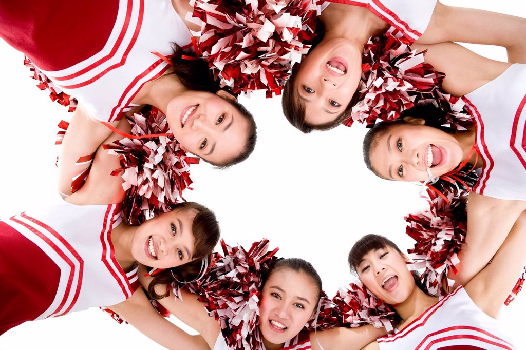 A cheerleader huddle : Stock Photo