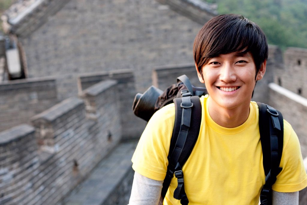 Stock Photo: 1839R-26084 Young people go hiking on the Great Wall
