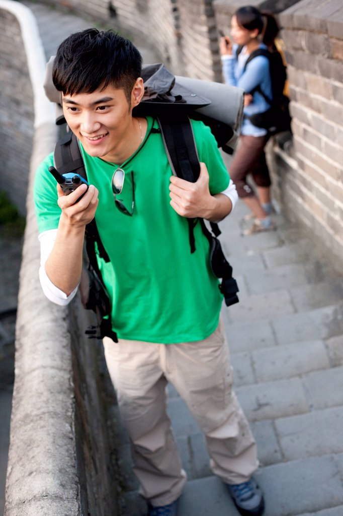 Stock Photo: 1839R-26085 Young people go hiking on the Great Wall