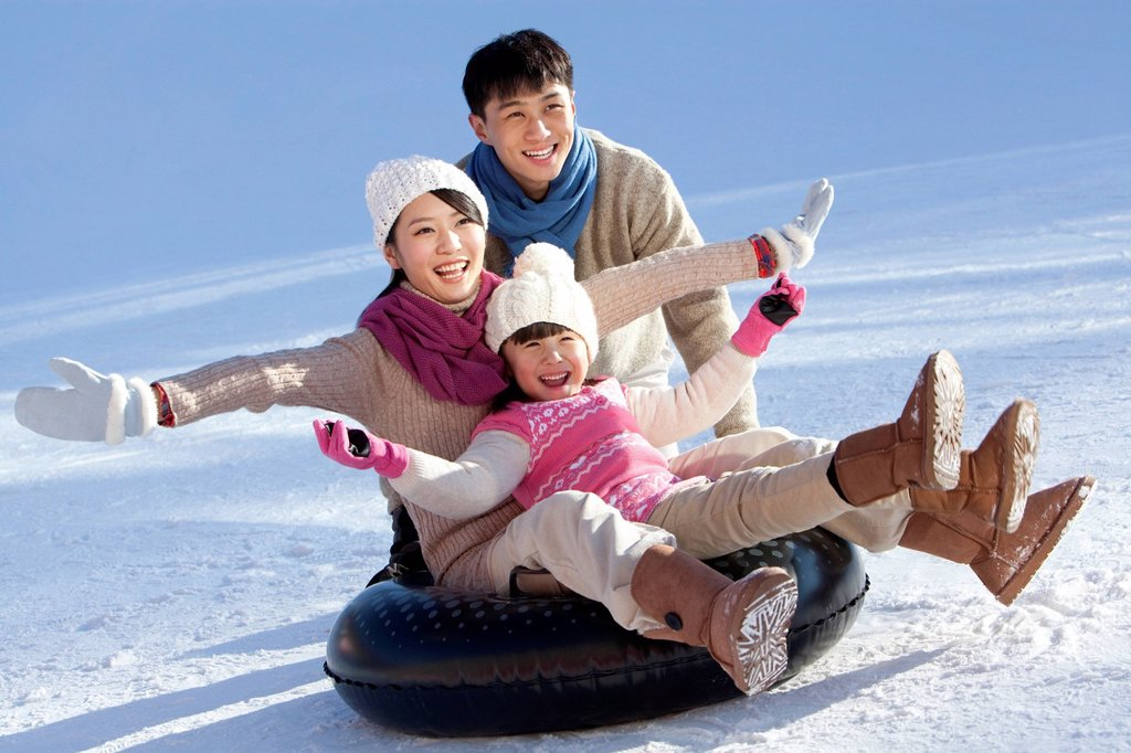 Stock Photo: 1839R-26260 Family having fun in snow