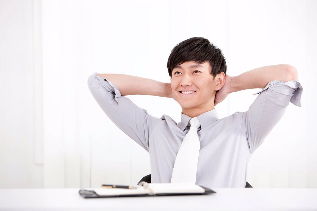 Stock Photo: 1839R-26337 Young businessman taking a break in office