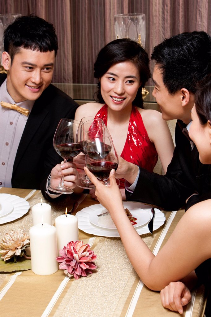 Stock Photo: 1839R-26359 Young people having dinner