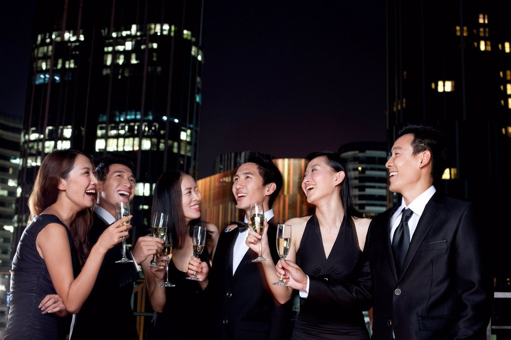 Stock Photo: 1839R-26830 Friends Celebrating at an Outdoor Bar