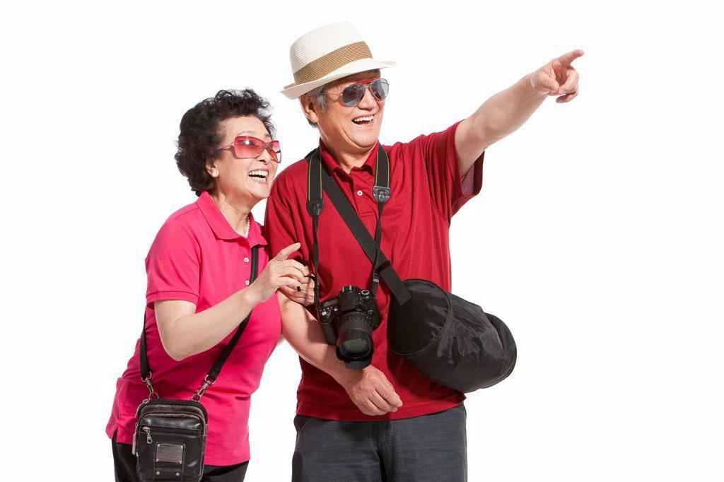 Portrait of senior couple travelling : Stock Photo