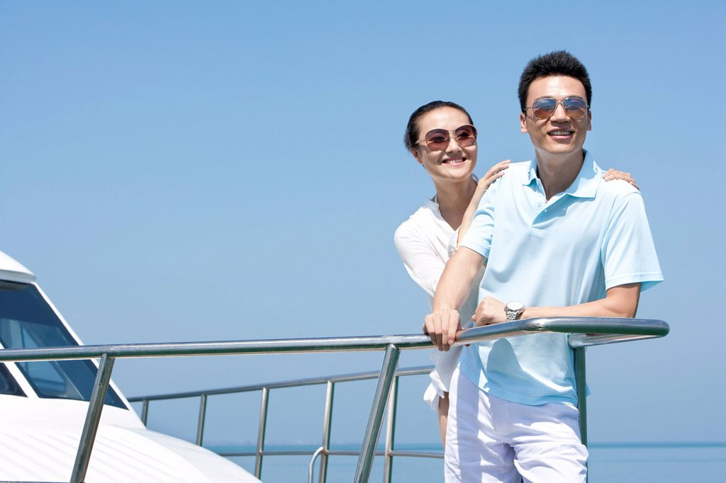 Stock Photo: 1839R-27429 Couple Enjoying the View from the Yacht Deck