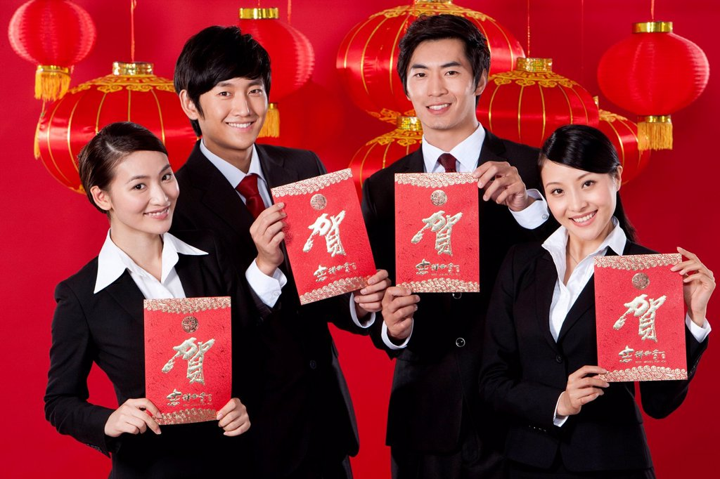 Stock Photo: 1839R-27671 Business Team Holding Red Envelopes