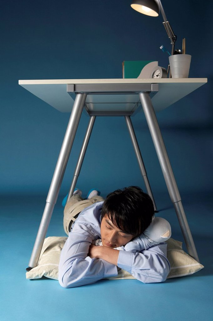 Man Sleeping Under His Desk : Stock Photo