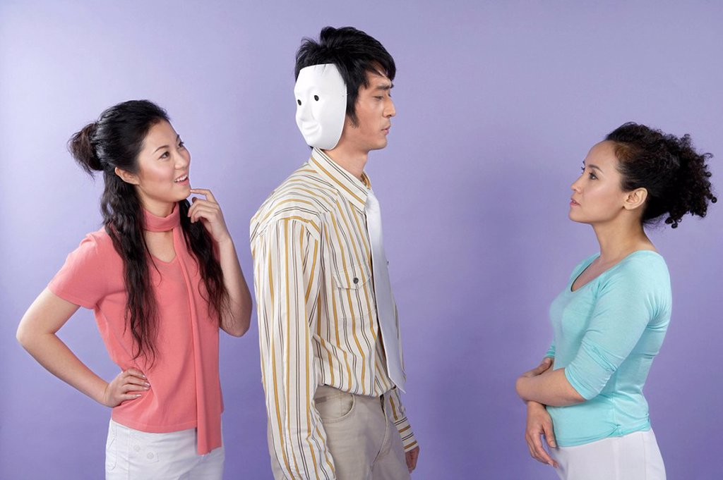 Stock Photo: 1839R-2817 Young Women Talking To A Two_Faced Man