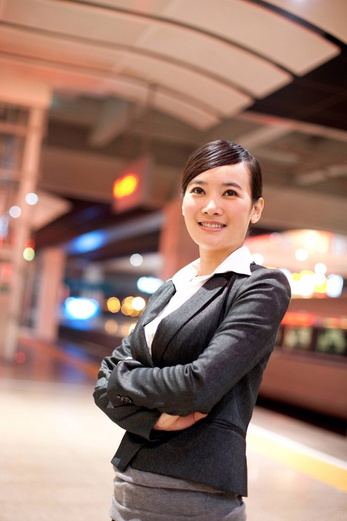 Stock Photo: 1839R-28573 Young businesswoman contemplating at the train station