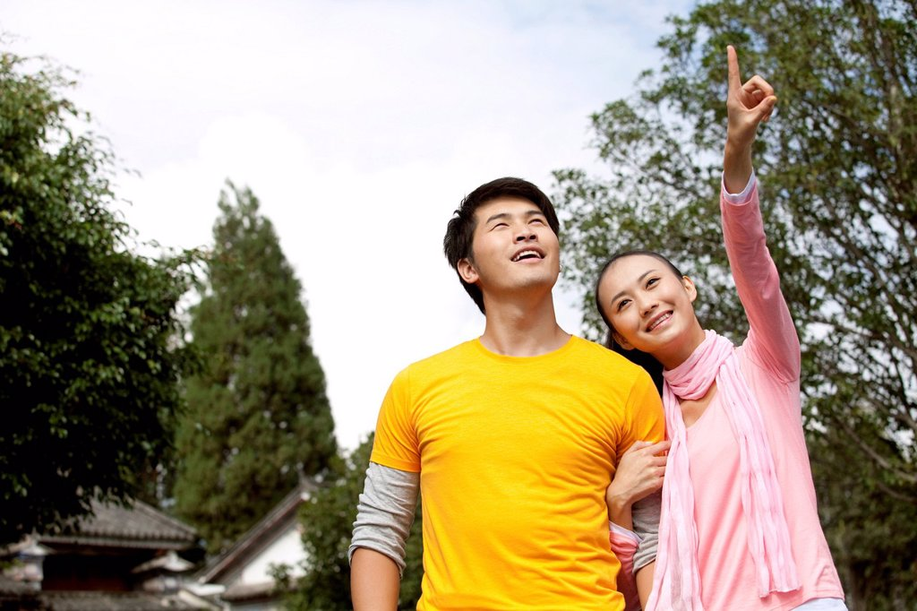 Stock Photo: 1839R-28948 Young Couple Exploring Dali