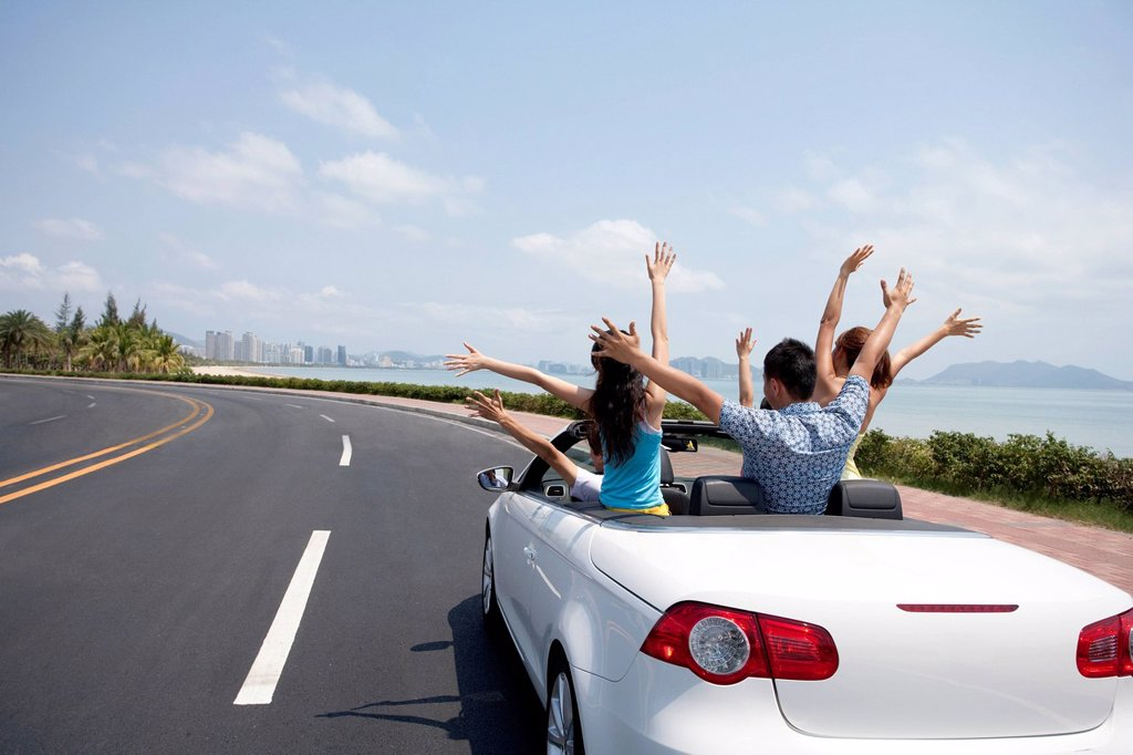 Stock Photo: 1839R-29103 Friends Having Fun in a Convertible