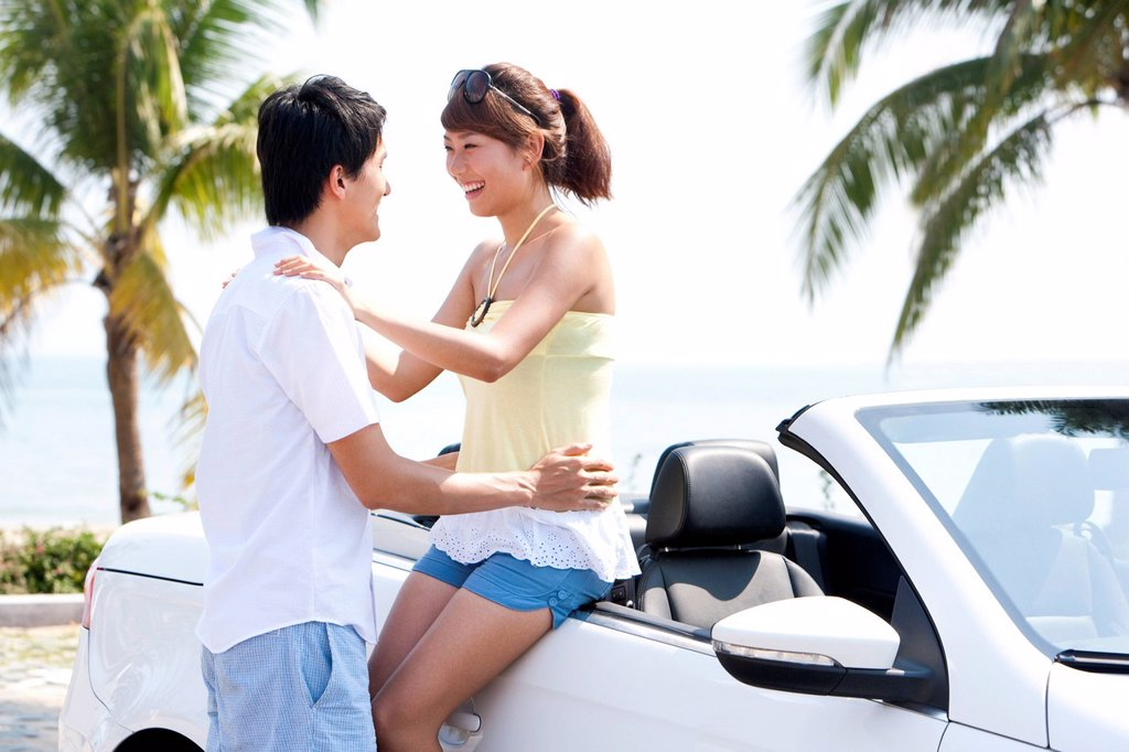 Stock Photo: 1839R-29108 Couple Having Fun in a Convertible