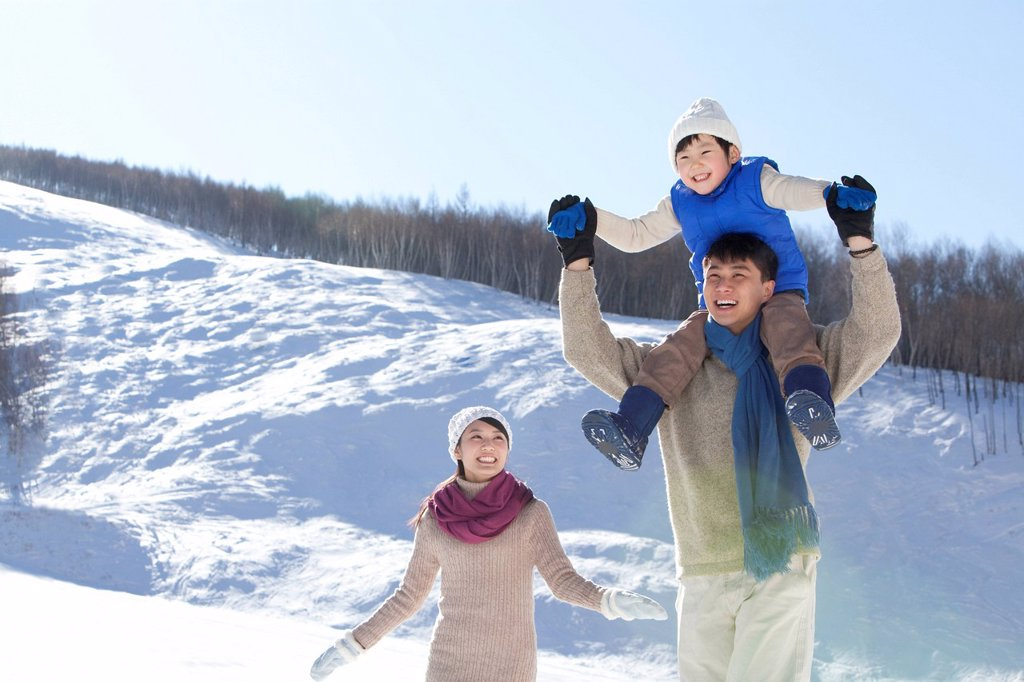 Stock Photo: 1839R-29454 Family having fun in snow