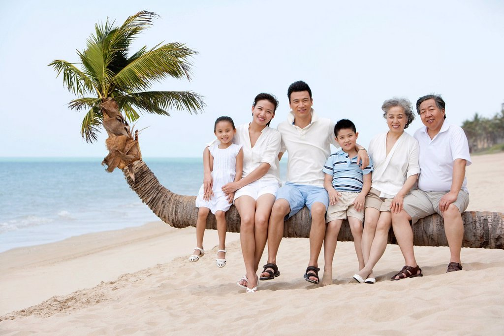 Stock Photo: 1839R-29849 Happy Family at the Beach