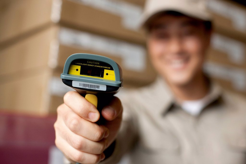 Stock Photo: 1839R-30116 Male Chinese warehouse worker with scanner