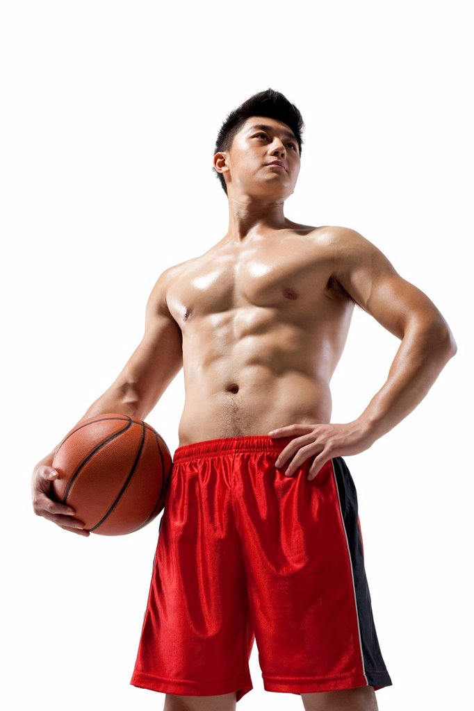 Stock Photo: 1839R-30182 Shirtless muscular man holding a basketball