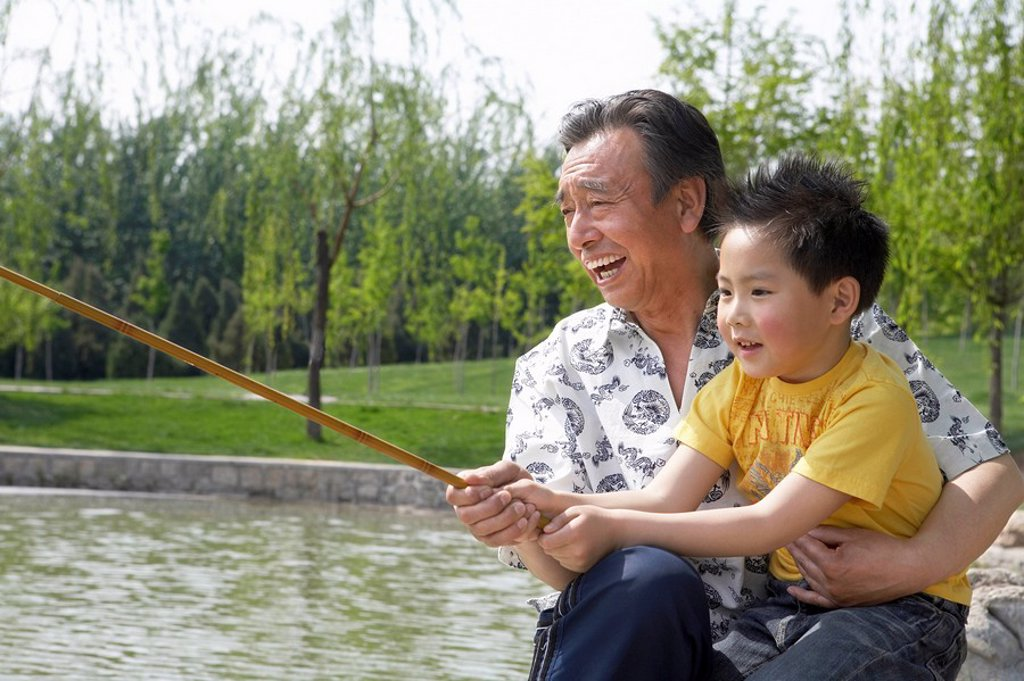 Grandfather Fishing With His Grandson : Stock Photo