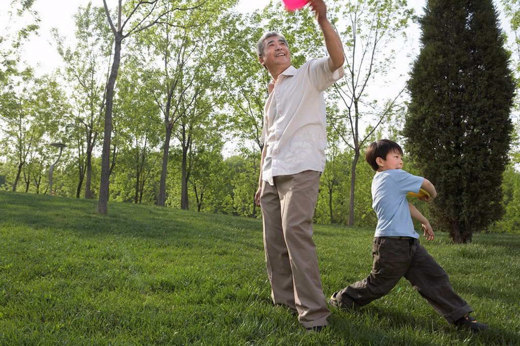 Man And Boy Playing In The Park : Stock Photo