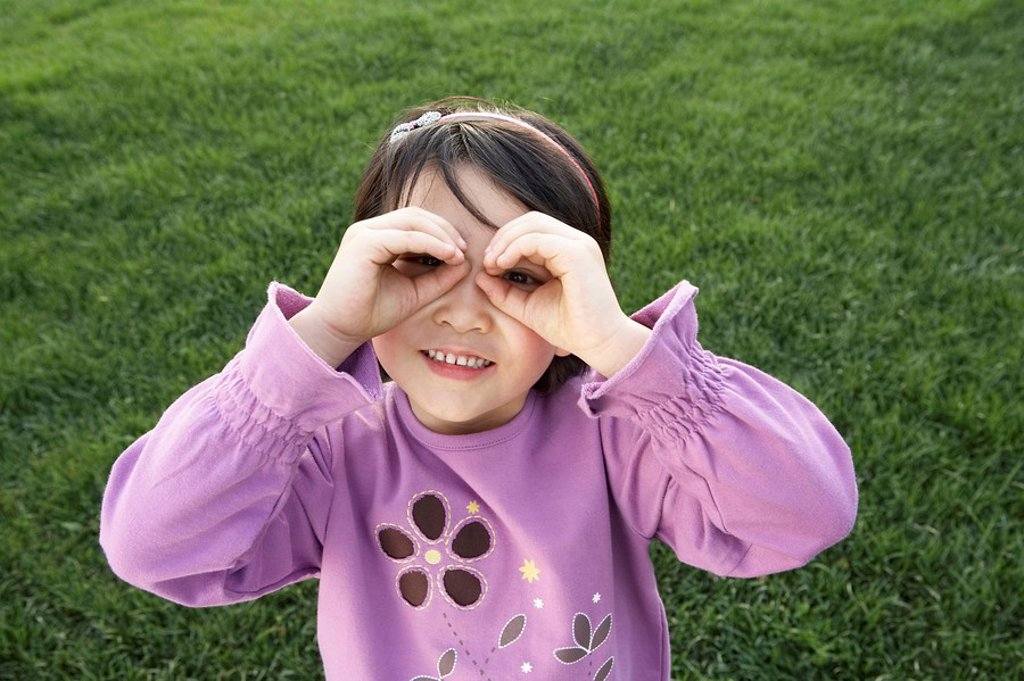Stock Photo: 1839R-3034 Portrait Of Young Girl In The Park