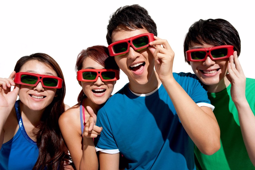 Stock Photo: 1839R-30774 Young people waching 3D movie