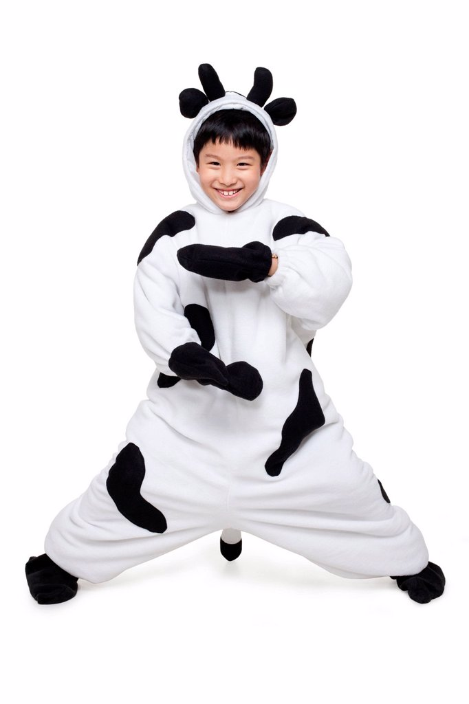 Stock Photo: 1839R-30827 Boy Dressed in a Cow Costume Practicing Taiji