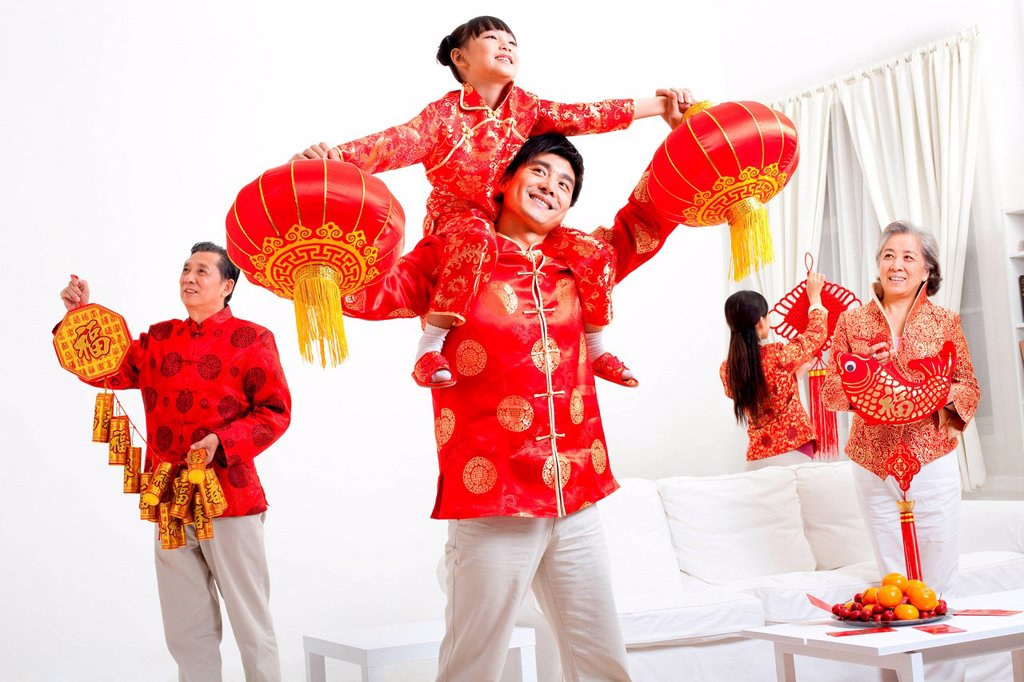 Stock Photo: 1839R-30890 Family putting up Chinese New Year decorations