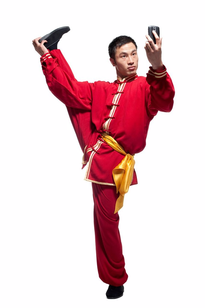 Stock Photo: 1839R-31409 Focused Man Doing Martial Arts in Chinese Clothing