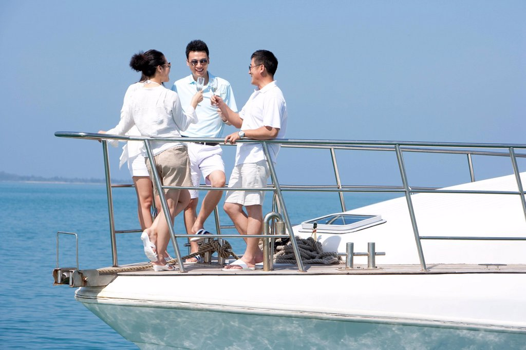 Stock Photo: 1839R-31432 Friends Celebrating with Champagne on a Yacht