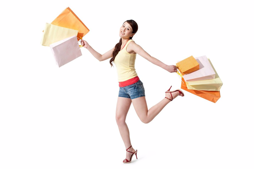Happy young woman with shopping bags : Stock Photo