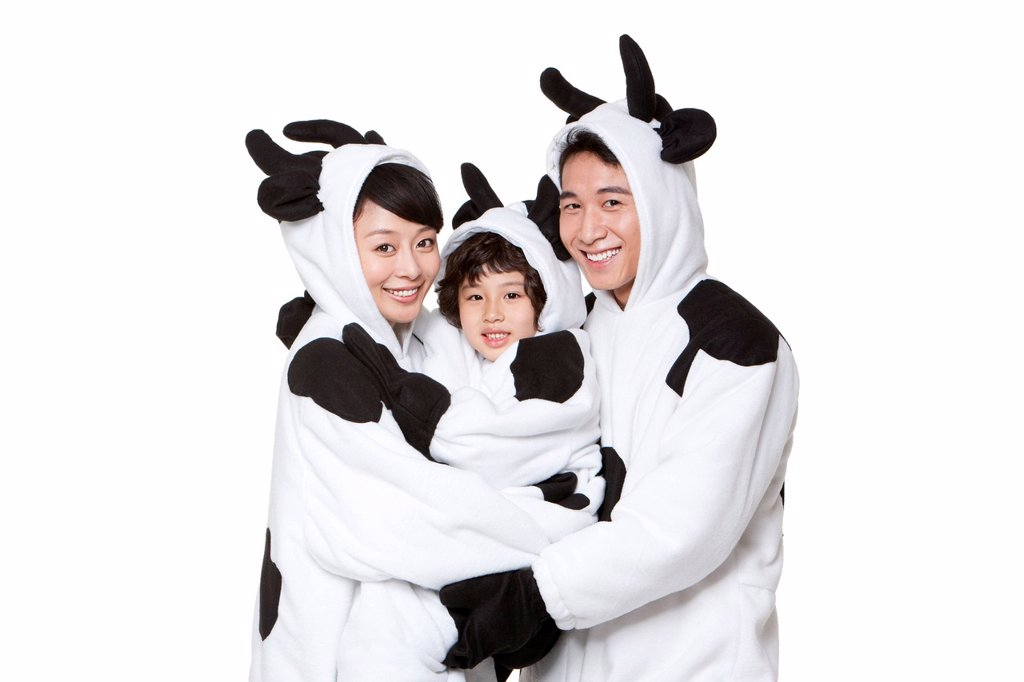 Stock Photo: 1839R-31658 Family in cow costumes embracing each other
