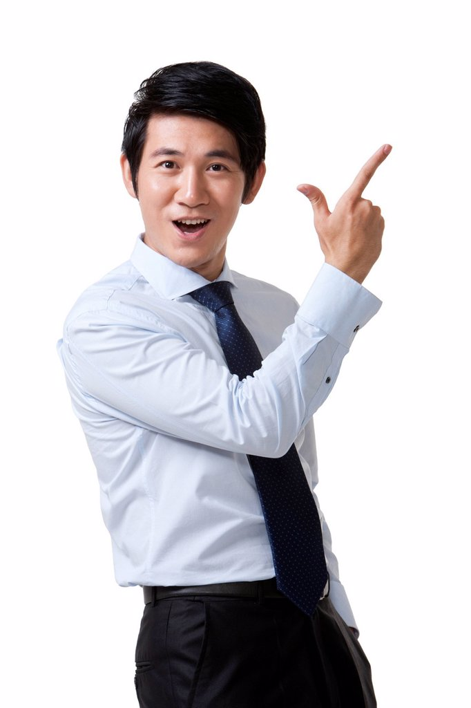 Stock Photo: 1839R-31665 Portrait of an Excited Businessman Pointing