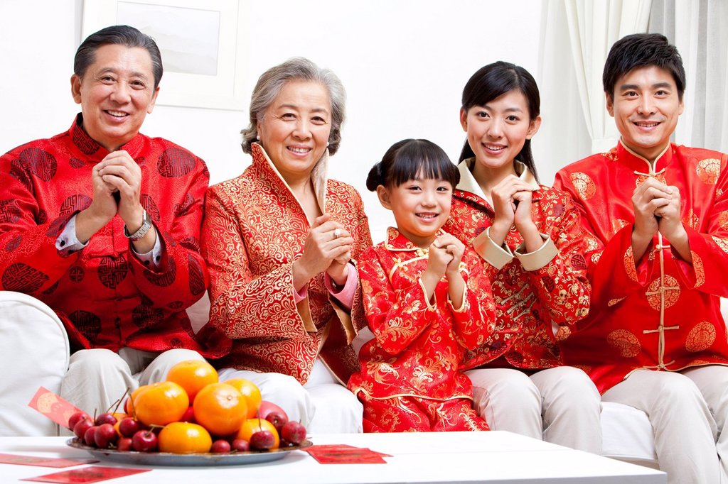 Family Celebrating Chinese New Year : Stock Photo