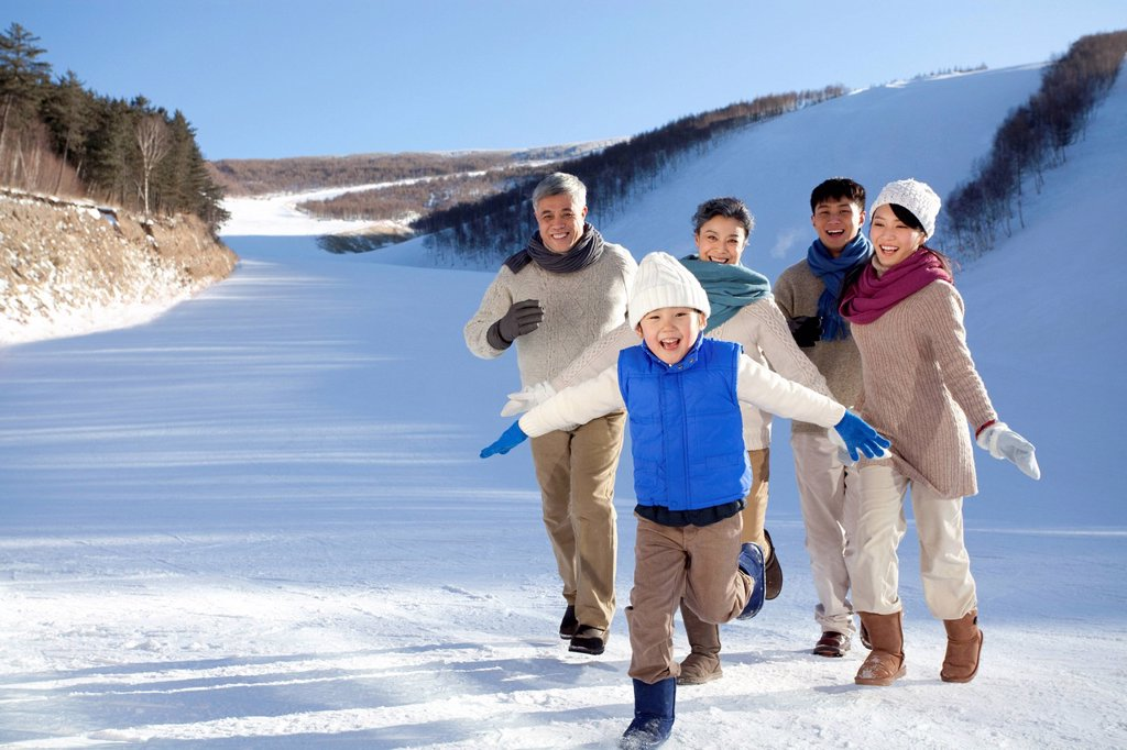 Family having fun in snow : Stock Photo